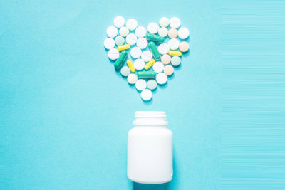 heart shape of vitamins and tablets