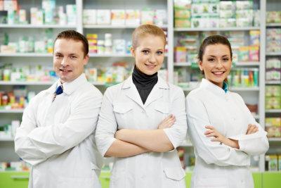 Cheerful pharmacist chemist women standing in pharmacy drugstore