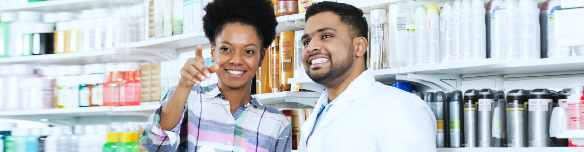 male pharmacist and woman smiling